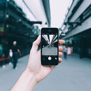 hand capturing photo vertically
